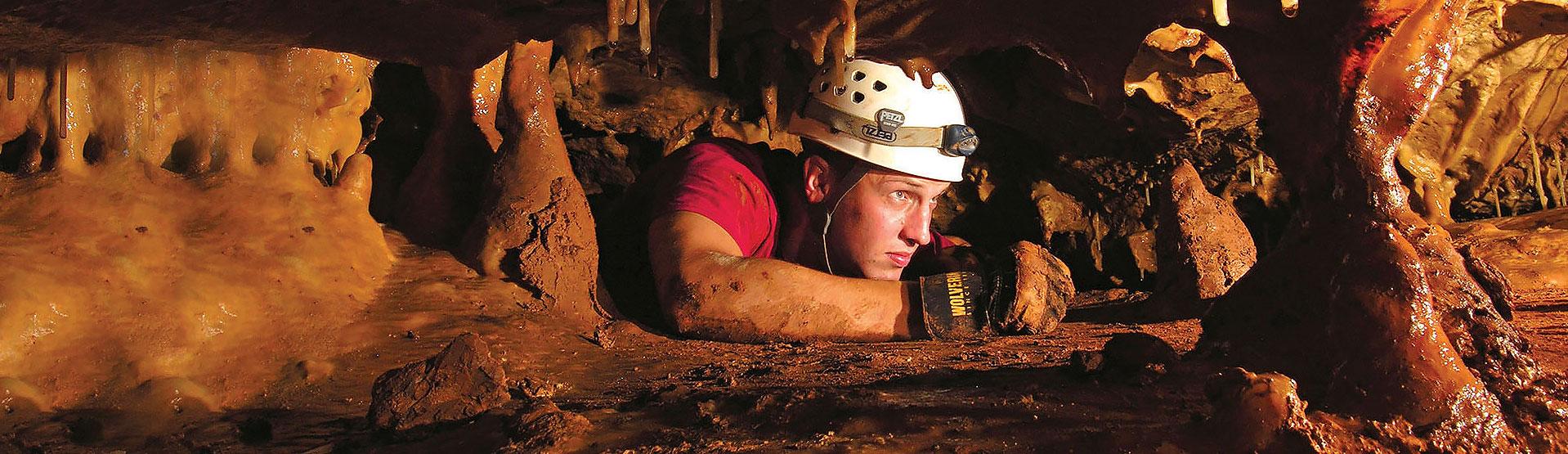 Man Exploring Cave