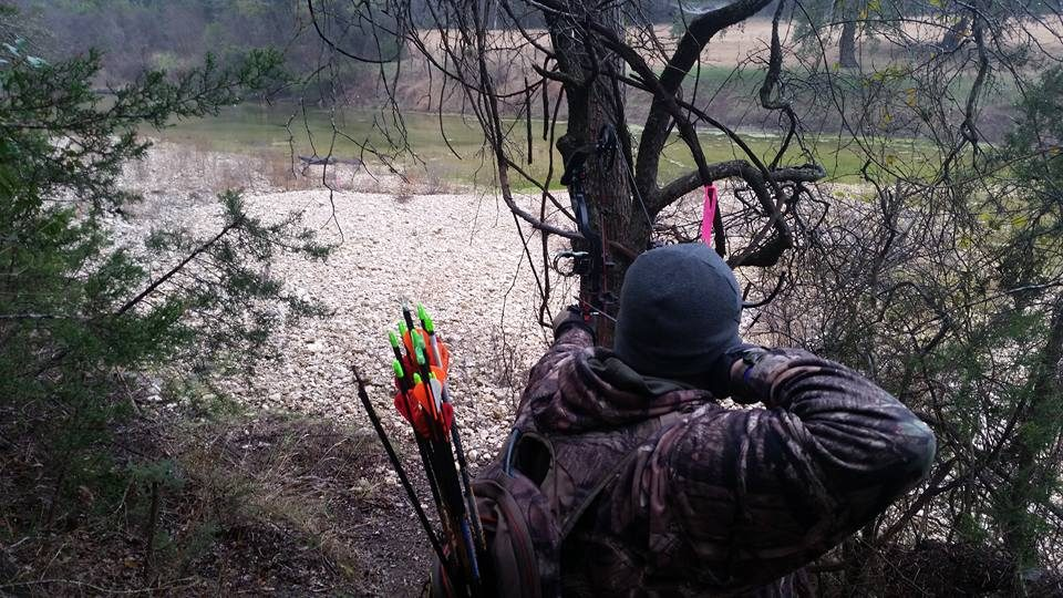 Man in Camo Shooting Bow