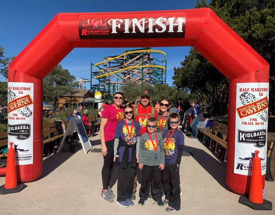 Family at Finish Line of Trail Run | Natural Bridge Caverns