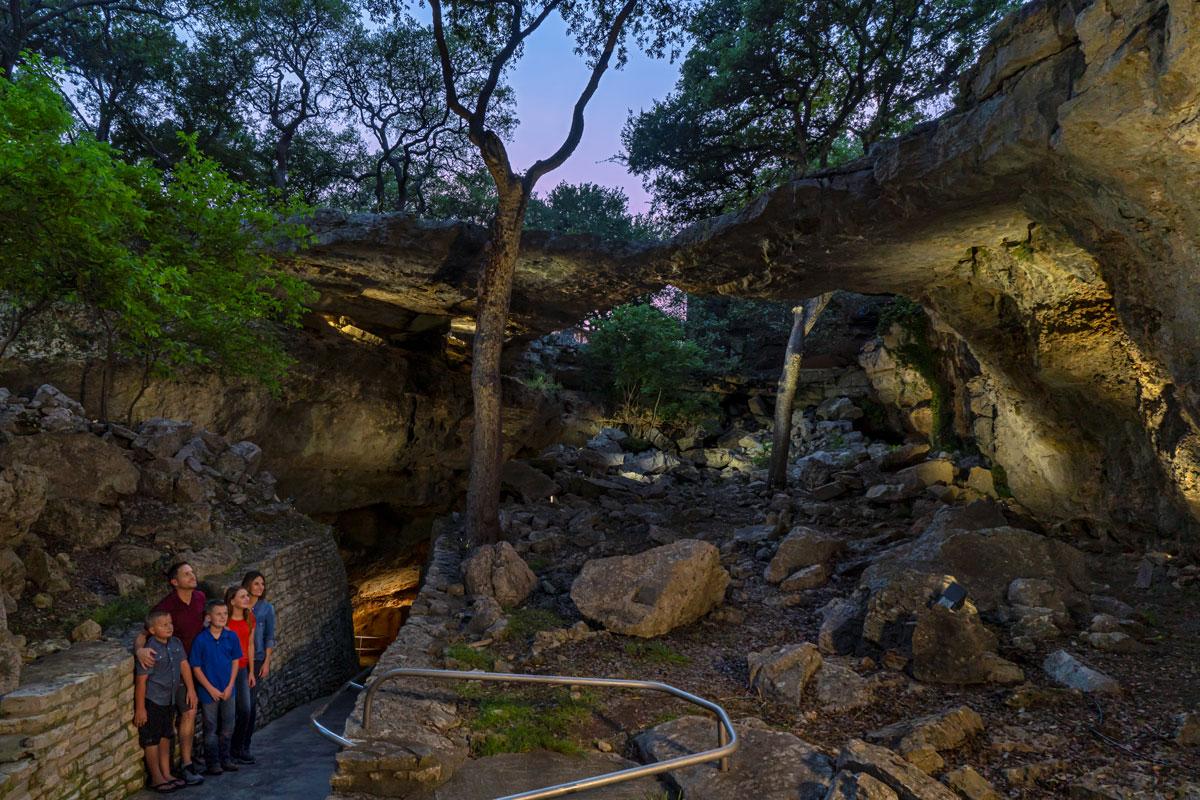 Family looking at Natural Bridge | Natural Bridge Caverns